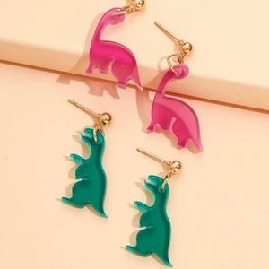 2 pair dinasour earrings.